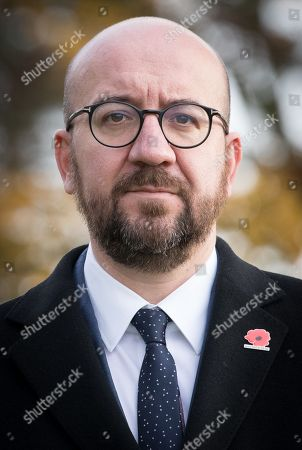 Belgian Prime Minister Charles Michel during the commemoration of the 100th anniversary of the end of the First World War at the Saint-Symphorien Military Cemetery, in Saint-Symphorien, Mons Belgium 09 November 2018. The cemetery at St. Symphorien was established by the German Army in August 1914 as the final resting place for British and German soldiers who were killed in the Battle of Mons. Among those buried here is Private John Parr of the Middlesex Regiment who was fatally wounded during an encounter with a German patrol two days before the battle, thus becoming the first British soldier to be killed in action on the Western Front. The cemetery remained in German hands until the end of the war and also contains the graves of Commonwealth and German soldiers who were killed in the final days of the conflict, including George Ellison of the Royal Irish Lancers and George Price of the Canadian Infantry. Ellison and Price were killed on Armistice Day 11 November 1918 and are believed to be the last Commonwealth casualties of the First World War. In total, there are 284 German and 230 Commonwealth casualties buried in this site.
