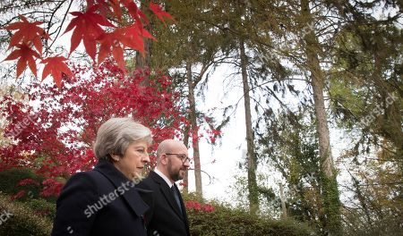 British Prime Minister Theresa May (L) and Belgian Prime Minister Charles Michel (R) during the commemoration of the 100th anniversary of the end of the First World War at the Saint-Symphorien Military Cemetery, in Saint-Symphorien, Mons Belgium 09 November 2018. The cemetery at St. Symphorien was established by the German Army in August 1914 as the final resting place for British and German soldiers who were killed in the Battle of Mons. Among those buried here is Private John Parr of the Middlesex Regiment who was fatally wounded during an encounter with a German patrol two days before the battle, thus becoming the first British soldier to be killed in action on the Western Front. The cemetery remained in German hands until the end of the war and also contains the graves of Commonwealth and German soldiers who were killed in the final days of the conflict, including George Ellison of the Royal Irish Lancers and George Price of the Canadian Infantry. Ellison and Price were killed on Armistice Day 11 November 1918 and are believed to be the last Commonwealth casualties of the First World War. In total, there are 284 German and 230 Commonwealth casualties buried in this site.