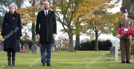 British Prime Minister Theresa May (L) and Belgian Prime Minister Charles Michel (C) during the commemoration of the 100th anniversary of the end of the First World War at the Saint-Symphorien Military Cemetery, in Saint-Symphorien, Mons Belgium 09 November 2018. The cemetery at St. Symphorien was established by the German Army in August 1914 as the final resting place for British and German soldiers who were killed in the Battle of Mons. Among those buried here is Private John Parr of the Middlesex Regiment who was fatally wounded during an encounter with a German patrol two days before the battle, thus becoming the first British soldier to be killed in action on the Western Front. The cemetery remained in German hands until the end of the war and also contains the graves of Commonwealth and German soldiers who were killed in the final days of the conflict, including George Ellison of the Royal Irish Lancers and George Price of the Canadian Infantry. Ellison and Price were killed on Armistice Day 11 November 1918 and are believed to be the last Commonwealth casualties of the First World War. In total, there are 284 German and 230 Commonwealth casualties buried in this site.