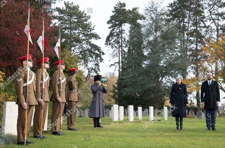 British Prime Minister Theresa May (2-R) and Belgian Prime Minister Charles Michel (R) during the commemoration of the 100th anniversary of the end of the First World War at the Saint-Symphorien Military Cemetery, in Saint-Symphorien, Mons Belgium 09 November 2018. The cemetery at St. Symphorien was established by the German Army in August 1914 as the final resting place for British and German soldiers who were killed in the Battle of Mons. Among those buried here is Private John Parr of the Middlesex Regiment who was fatally wounded during an encounter with a German patrol two days before the battle, thus becoming the first British soldier to be killed in action on the Western Front. The cemetery remained in German hands until the end of the war and also contains the graves of Commonwealth and German soldiers who were killed in the final days of the conflict, including George Ellison of the Royal Irish Lancers and George Price of the Canadian Infantry. Ellison and Price were killed on Armistice Day 11 November 1918 and are believed to be the last Commonwealth casualties of the First World War. In total, there are 284 German and 230 Commonwealth casualties buried in this site.