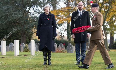 British Prime Minister Theresa May (L) and Belgian Prime Minister Charles Michel during the commemoration of the 100th anniversary of the end of the First World War at the Saint-Symphorien Military Cemetery, in Saint-Symphorien, Mons Belgium 09 November 2018. The cemetery at St. Symphorien was established by the German Army in August 1914 as the final resting place for British and German soldiers who were killed in the Battle of Mons. Among those buried here is Private John Parr of the Middlesex Regiment who was fatally wounded during an encounter with a German patrol two days before the battle, thus becoming the first British soldier to be killed in action on the Western Front. The cemetery remained in German hands until the end of the war and also contains the graves of Commonwealth and German soldiers who were killed in the final days of the conflict, including George Ellison of the Royal Irish Lancers and George Price of the Canadian Infantry. Ellison and Price were killed on Armistice Day 11 November 1918 and are believed to be the last Commonwealth casualties of the First World War. In total, there are 284 German and 230 Commonwealth casualties buried in this site.