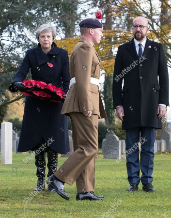 Stock Photo of British Prime Minister Theresa May (L) and Belgian Prime Minister Charles Michel (R) during the commemoration of the 100th anniversary of the end of the First World War at the Saint-Symphorien Military Cemetery, in Saint-Symphorien, Mons Belgium 09 November 2018. The cemetery at St. Symphorien was established by the German Army in August 1914 as the final resting place for British and German soldiers who were killed in the Battle of Mons. Among those buried here is Private John Parr of the Middlesex Regiment who was fatally wounded during an encounter with a German patrol two days before the battle, thus becoming the first British soldier to be killed in action on the Western Front. The cemetery remained in German hands until the end of the war and also contains the graves of Commonwealth and German soldiers who were killed in the final days of the conflict, including George Ellison of the Royal Irish Lancers and George Price of the Canadian Infantry. Ellison and Price were killed on Armistice Day 11 November 1918 and are believed to be the last Commonwealth casualties of the First World War. In total, there are 284 German and 230 Commonwealth casualties buried in this site.