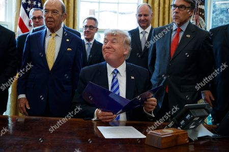 Donald Trump, Haider al-Abadi. President Donald Trump, flanked by Commerce Secretary Wilbur Ross, left, and Energy Secretary Rick Perry, is seen in the Oval Office of the White House in Washington, during the announcing of the approval of a permit to build the Keystone XL pipeline, clearing the way for the $8 billion project.A federal judge in Montana has blocked construction of the $8 billion Keystone XL Pipeline to allow more time to study the project's potential environmental impact. U.S. District Judge Brian Morris' order, came as Calgary-based TransCanada was preparing to build the first stages of the oil pipeline in northern Montana. Environmental groups had sued TransCanada and The U.S. Department of State in federal court in Great Falls