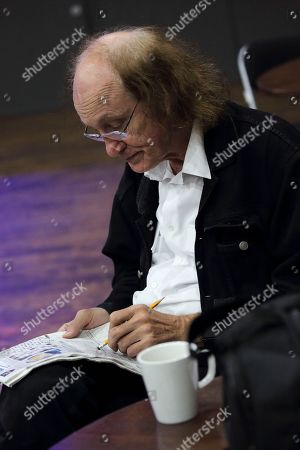 Stock Picture of John Otway relaxes backstage with a crossword