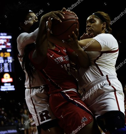 Piscataway, New Jersey, U.S. - Rutgers Scarlet Knights forward Stasha Carey (35) and center Jordan Wallace (44) put defense pressure on Stony Brook Seawolves forward Kina Smith (12) in the first half during a game between the Rutgers Scarlet Knights and the Stony Brook Seawolves at Rutgers Athletic Center in Piscataway, New Jersey