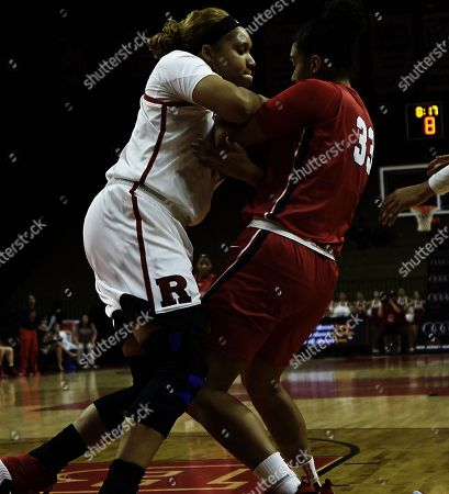 Piscataway, New Jersey, U.S. - Rutgers Scarlet Knights center Jordan Wallace (44) and Stony Brook Seawolves forward India Pagan (33) battle for a rebound in the first half during a game between the Rutgers Scarlet Knights and the Stony Brook Seawolves at Rutgers Athletic Center in Piscataway, New Jersey. Rutgers defeated Stony Brook 61-47