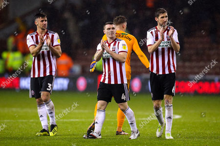Enda Stevens, John Fleck and Chris Basham of Sheffield United cut frustrated figures after his side draw with Sheffield Wednesday