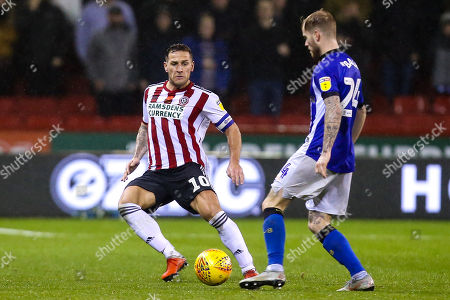 Billy Sharp of Sheffield United challenges Ashley Baker of Sheffield Wednesday