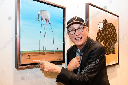 German comedian Otto Waalkes poses in front of his pictures in the exhibition 'Saitenspruenge - Wenn Musiker malen' (lit. string escapade - when musicians paint) at the Kornhausforum in Bern, Switzerland, 09 November 2018. The exhibition runs from 10 to 25 November.