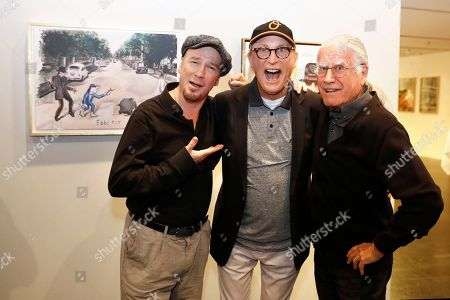 German comedian Otto Waalkes (C) poses with Swiss musicians Mario Capitanio (L) and Toni Vescoli in front of his pictures in the exhibition 'Saitenspruenge - Wenn Musiker malen' (lit. string escapade - when musicians paint) at the Kornhausforum in Bern, Switzerland, 09 November 2018. The exhibition runs from 10 to 25 November.