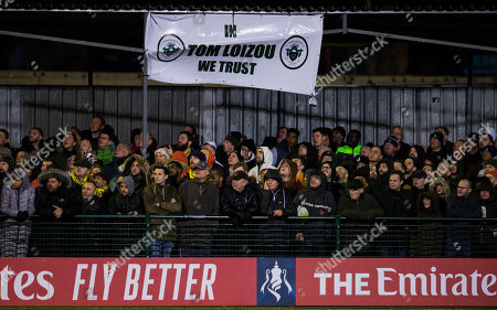 A sign about Tom Loizou manager of Haringey Borough hangs from the stand
