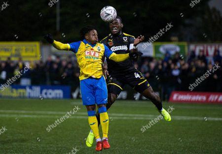 Michael Ademiluyi of Haringey Borough and Deji Oshilaja of AFC Wimbledon