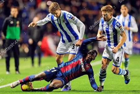 Levante's Ghanaian striker Emmanuel Boateng (bottom) in action against Real Sociedad players Diego Llorente (L) and Asier Illarramendi (R) during the Spanish La Liga soccer match between Levante UD and Real Sociedad in Valencia, eastern Spain, 09 November 2018.