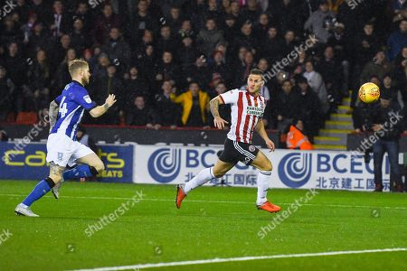 Billy Sharp of Sheffield United (10) attacks forward with Ashley Baker of Sheffield Wednesday (24) chasing him down during the EFL Sky Bet Championship match between Sheffield United and Sheffield Wednesday at Bramall Lane, Sheffield