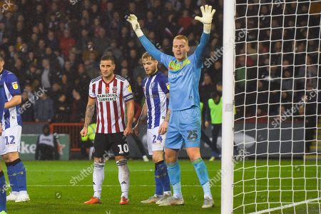 Billy Sharp of Sheffield United (10) waits for a corner kick being marked by Ashley Baker of Sheffield Wednesday (24) and Cameron Dawson of Sheffield Wednesday (25) during the EFL Sky Bet Championship match between Sheffield United and Sheffield Wednesday at Bramall Lane, Sheffield