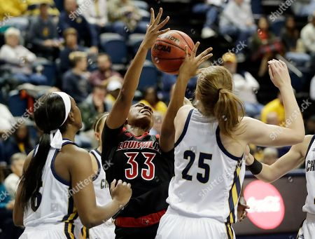 Bionca Dunham, Eboni Williams, Abbey Cornelius. Louisville forward Bionca Dunham (33) fights for the ball with Chattanooga forwards Eboni Williams, left and Abbey Cornelius (25) in the second half of an NCAA college basketball game, in Chattanooga, Tenn. Louisville won 75-49