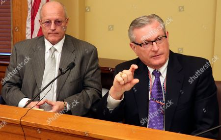 Raney Gilliland, right, the director of the Kansas Legislative Research Department, discusses a new, more optimistic fiscal forecast for state government during a news conference, at the Statehouse in Topeka, Kan. To his left is Larry Campbell, budget director for departing Republican Gov. Jeff Colyer