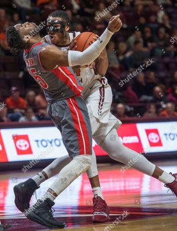 Virginia Tech forward Kerry Blackshear Jr. drives on Gardner-Webb guard Jose Perez (5) during the second half of an NCAA college basketball game, in Blacksburg, Va. Virginia Tech won 87-59