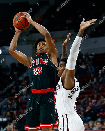 Austin Peay guard Steve Harris (23) goes up for a shot over Mississippi State guard Nick Weatherspoon (0) during the second half of an NCAA college basketball game, in Starkville, Miss. Mississippi State won 95-67