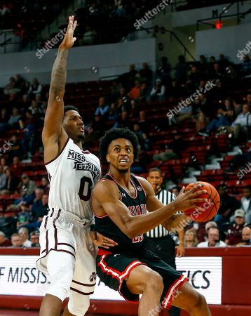 Austin Peay guard Steve Harris (23) goes up for a shot as Mississippi State guard Nick Weatherspoon (0) defends during the second half of an NCAA college basketball game, in Starkville, Miss