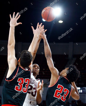 Mississippi State guard Tyson Carter (23) puts up a shot over Austin Peay center Ivan Cucak (33) and guard Steve Harris (23) during the first half of an NCAA college basketball game, in Starkville, Miss