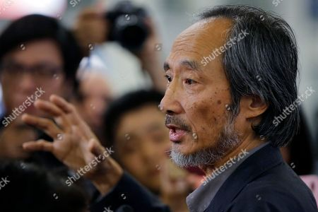 Chinese dissident writer Ma Jian speaks to media after arriving Hong Kong international airport. Concerns have been raised about freedom of expression in Hong Kong following the cancellation of literary and artistic events and the refusal to allow a Financial Times editor to enter the semi-autonomous Chinese territory. The author Ma Jian is still planning to enter the city amid plans to arrange an alternative venue, while Chinese-Australian artist Badiucao's show was called-off after alleged threats from Chinese authorities. Financial Times' Victor Mallet was turned around at the airport