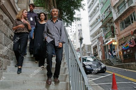 Chinese dissident writer Ma Jian, right, walks out the Tai Kwun venue, which is hosting the Hong Kong International Literary Festival, in Hong Kong, . Concerns have been raised about freedom of expression in Hong Kong following the cancellation of literary and artistic events and the refusal to allow an editor from the Financial Times to enter the semi-autonomous Chinese territory