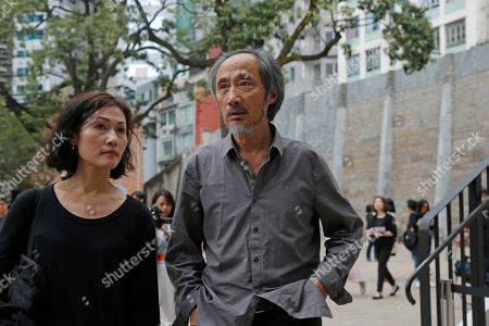 Chinese dissident writer Ma Jian, right, leaves after a press conference at the Tai Kwun venue, which is hosting the Hong Kong International Literary Festival, in Hong Kong, . A Hong Kong arts venue has canceled the appearance at a literary festival of exiled Chinese writer Ma Jian, known for his novels criticizing China's ruling Communist Party. Ma tweeted that the Tai Kwun venue, which is hosting the Hong Kong International Literary Festival, said his two scheduled events had been scratched. He said no explanation was given