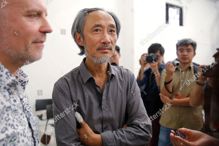 Stock Picture of Chinese dissident writer Ma Jian, center, chats with media after a press conference at the Tai Kwun venue, which is hosting the Hong Kong International Literary Festival, in Hong Kong, . A Hong Kong arts venue has canceled the appearance at a literary festival of exiled Chinese writer Ma Jian, known for his novels criticizing China's ruling Communist Party. Ma tweeted that the Tai Kwun venue, which is hosting the Hong Kong International Literary Festival, said his two scheduled events had been scratched. He said no explanation was given