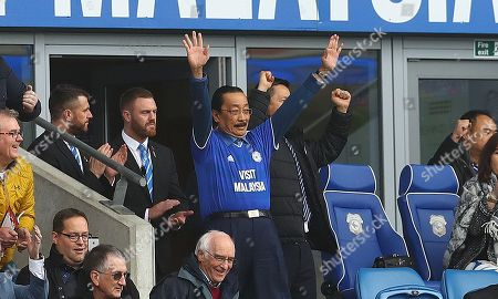 Cardiff City owner Vincent Tan celebrates on the final whistle wearing his club shirt having taken his jacket off in the final moments