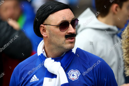 A supporter dressed as Cardiff City owner Vincent Tan