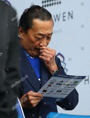 Cardiff City owner Vincent Tan in the stands studying the team sheet