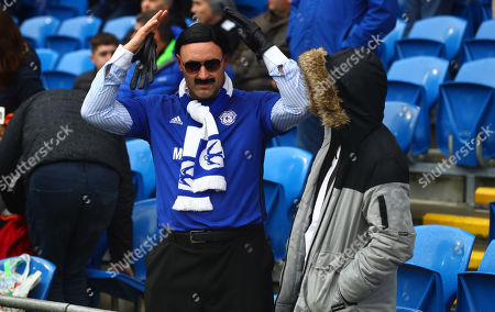 A Cardiff City fan dressed as owner Vincent Tan