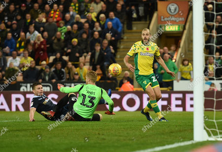 Shaun Hutchinson of Millwall collides with Ben Amos of Millwall which allows Teemu Pukki of Norwich City to score the winning goal, 4-3