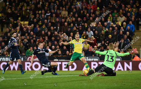 Shaun Hutchinson of Millwall dives in as Teemu Pukki of Norwich City shoots on the goal of Ben Amos of Millwall for the game-winning goal, 4-3