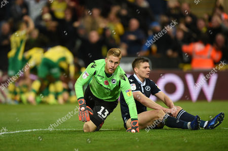 Goalkeeper Ben Amos of Millwall and Shaun Hutchinson of Millwall look dejected after the game-winning goal by Teemu Pukki of Norwich City, 4-3
