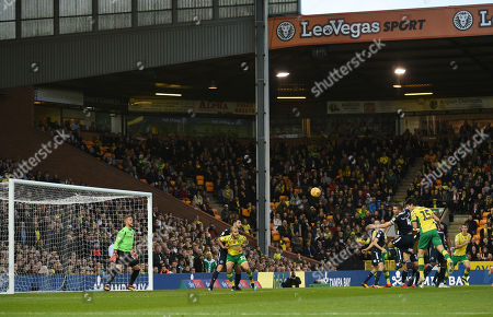 Timm Klose of Norwich City goes close to scoring on the goal of Ben Amos of Millwall