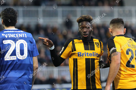 Maidstone captain, Blair Turgott, indicates to the referee, that Macclesfield's Peter Vincenti is the culprit rather than his teammate, Simon Walton during Maidstone United vs Macclesfield Town, Emirates FA Cup Football at the Gallagher Stadium on 10th November 2018