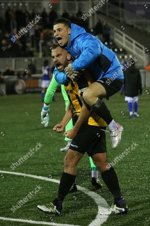 Jack Paxman leaps onto the back of Maidstone's Simon Walton at the final whistle to celebrate their victory during Maidstone United vs Macclesfield Town, Emirates FA Cup Football at the Gallagher Stadium on 10th November 2018