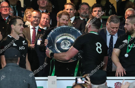 England vs New Zealand All Blacks. New Zealand's Kieran Read is presented with the Sir Edmund Hillary Shield by Duke of Sussex Prince Harry