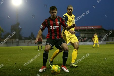 Stock Image of Ricky Griggs of Brightlingsea and Leon McKenzie of Hornchurch during Brightlingsea Regent vs AFC Hornchurch, Buildbase FA Trophy Football at North Road on 10th November 2018