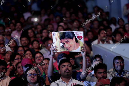 Fans welcome Bollywood actor Shahrukh Khan (on poster) during the 24th Kolkata International Film Festival, in Kolkata, India, 10 November 2018. This year Bengal cinema celebrates its 100-year anniversary. The festival runs from 10 to 17 November.
