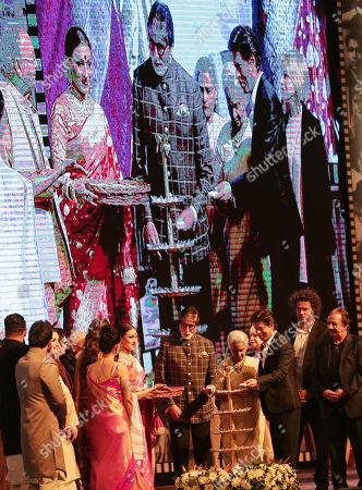 Stock Photo of Bollywood actors Amitabh Bachchan (C) and Shahrukh Khan (3-R) light a lamp during the 24th Kolkata International Film Festival, in Kolkata, India, 10 November 2018. This year Bengal cinema celebrates its 100-year anniversary. The festival runs from 10 to 17 November.