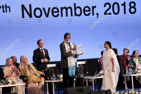Bollywood actor Amitabh Bachchan (C) shows a souvenir next to Chief Minister of Bengal Mamata Bannerjee (C-R) during the 24th Kolkata International Film Festival, in Kolkata, India, 10 November 2018. This year Bengal cinema celebrates its 100-year anniversary. The festival runs from 10 to 17 November.