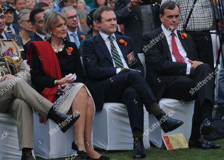 Stock Photo of British High Commissioner to India, Sir Dominic Asquith (R), his wife, Louise Asquith (L) and Tom Tugendhat MP, Chair of the Foreign Affairs Committee and former army officer, to the Indian Army and others attend an event at the residence of British High Commissioner to India, to mark 100th anniversary of the end of the First World War, in New Delhi, India, 10 November 2018. The contribution of the British Indian Army soldiers who fought with the British Army and its Allies in the First World War were acknowledged by Britishers and its Allies after the war. More than 74,000 Indian soldiers lost their lives during WWI. The 11 November 2018 marks the 100th anniversary of the First World War Armistice with services taking place across the world to commemorate the occasion.