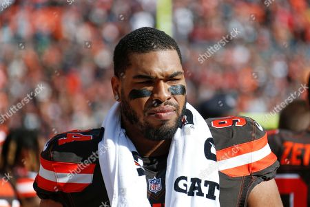 Stock Image of Cleveland Browns defensive lineman Carl Davis (94) stands on the sideline before an NFL football game against the Kansas City Chiefs, in Cleveland