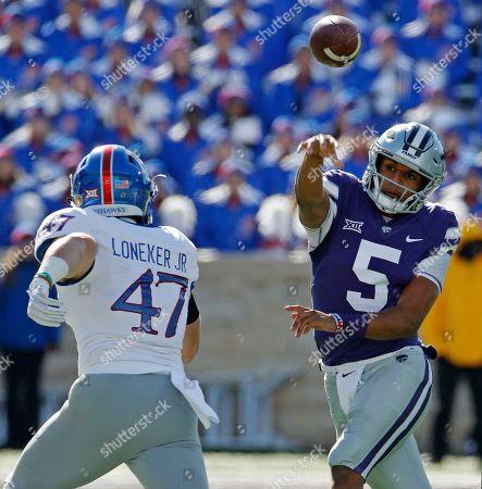 Kansas State quarterback Alex Delton (5) passes over Kansas linebacker Keith Loneker Jr. (47) during the first half of an NCAA college football game, in Manhattan, Kan