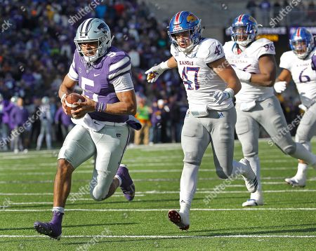 Kansas State quarterback Alex Delton (5) gets past Kansas linebacker Keith Loneker Jr. (47) to run the ball for a touchdown during the second half of an NCAA college football game, in Manhattan, Kan. Kansas State won 21-17