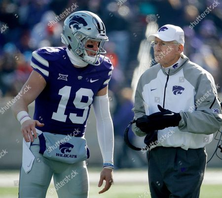 Kansas State defensive back Colby Dean Moore (19) talks to head coach Bill Snyder during the second half of an NCAA college football game against Kansas, in Manhattan, Kan. Kansas State won 21-17