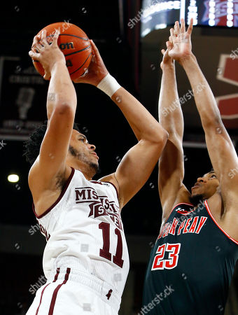 Quinndary Weatherspoon, Steve Harris. Mississippi State guard Quinndary Weatherspoon (11) puts up a shot over Austin Peay guard Steve Harris (23) during the first half of an NCAA college basketball game, in Starkville, Miss